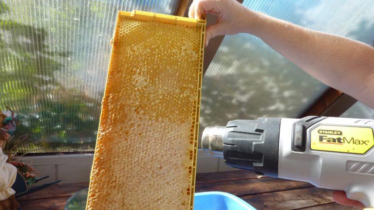 Heat gun method of removing wax cappings